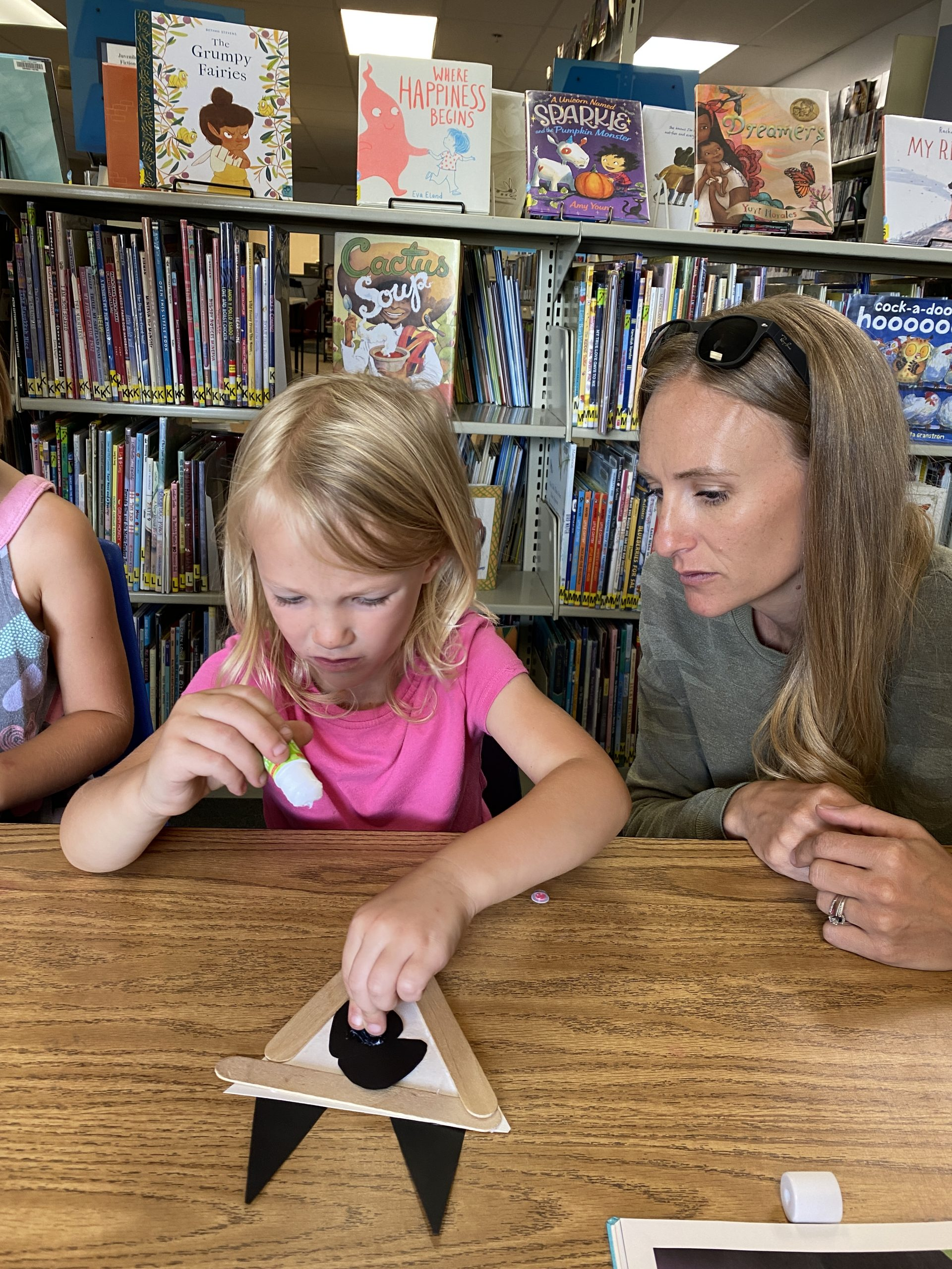 mom and daughter crafting at story time