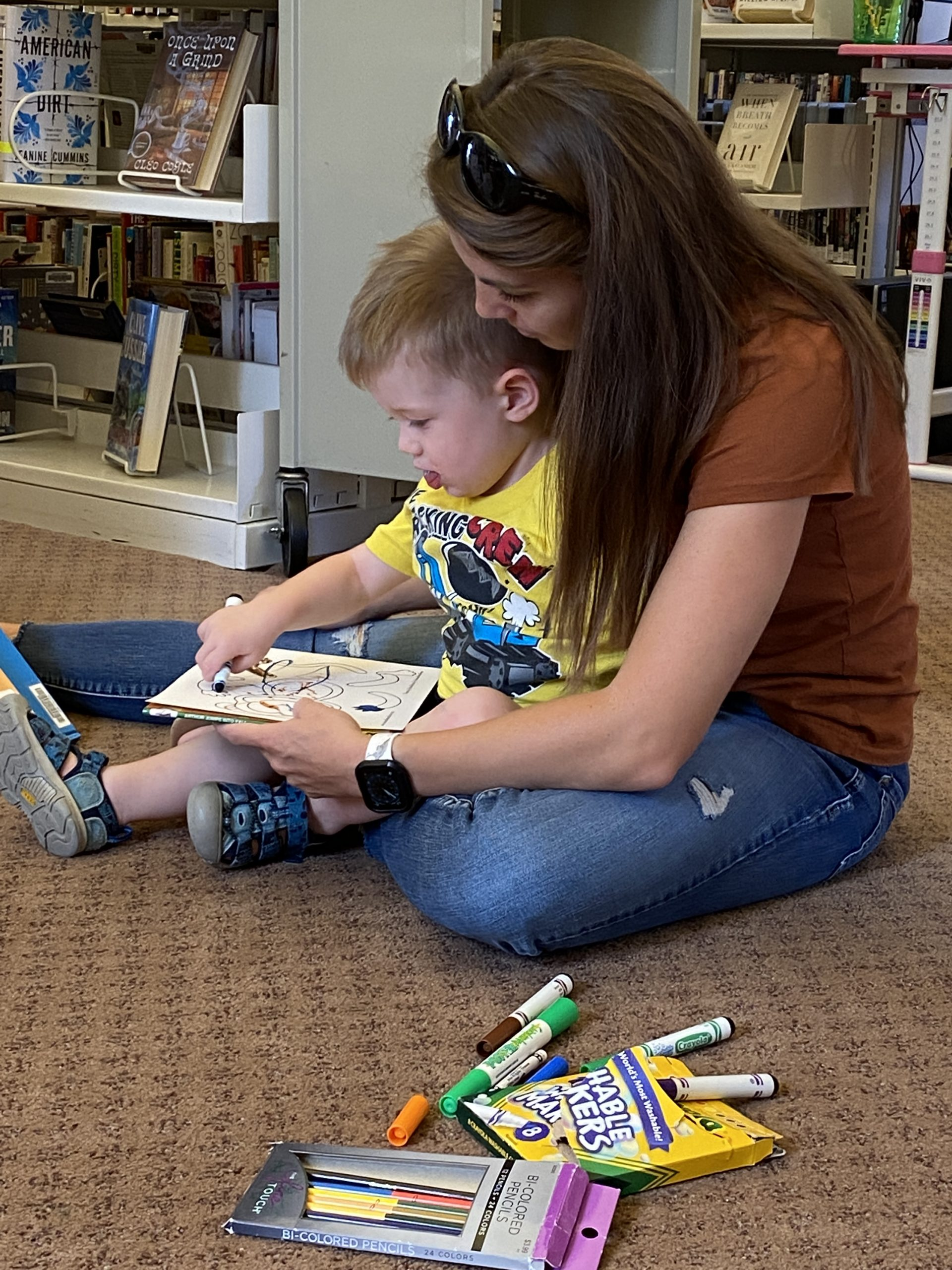 mom and son coloring at story time